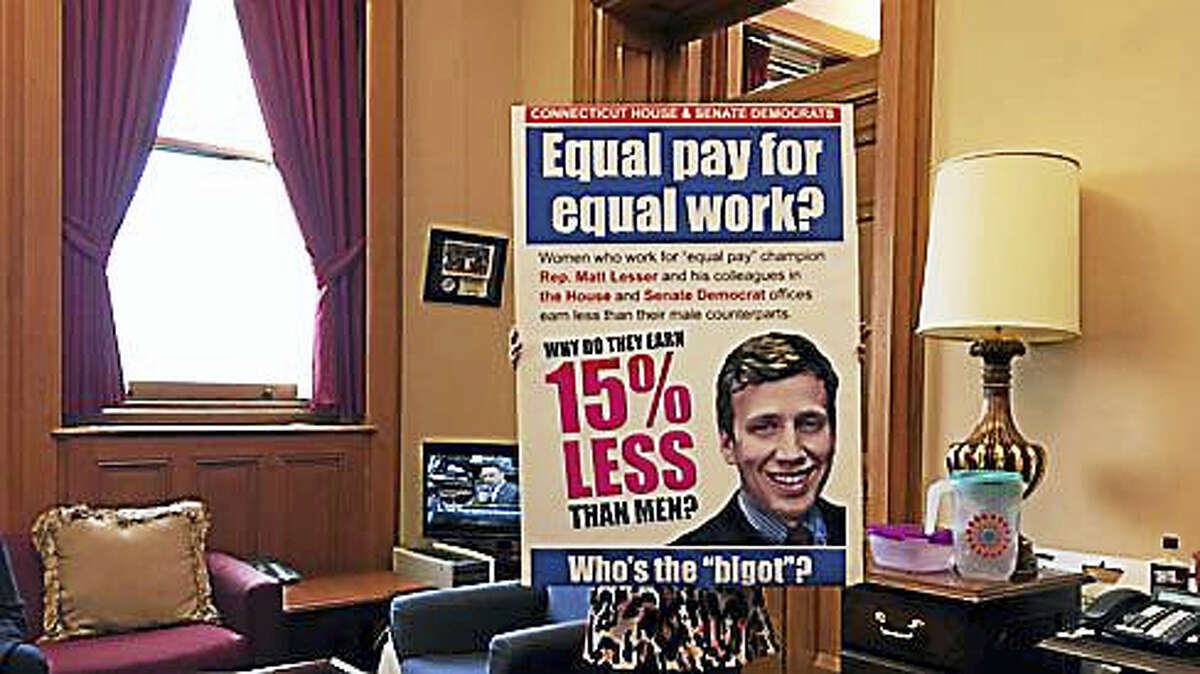 House Minority Leader Themis Klarides, R-Derby, displays a sign in her office.