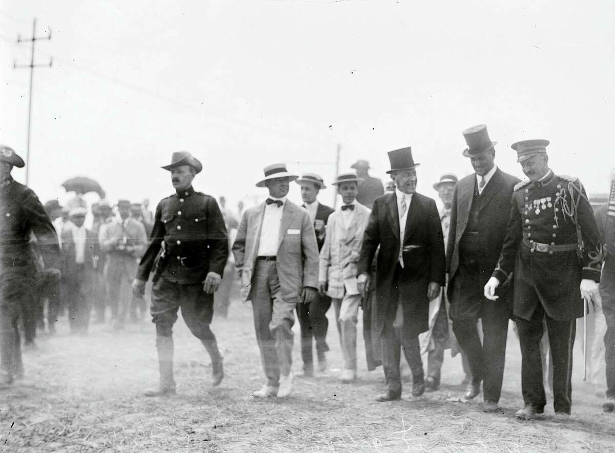 In this July 1913 photo made available by the Library of Congress, President Woodrow Wilson, third from right, attends a commemoration for the 50th anniversary of the Battle of Gettysburg.