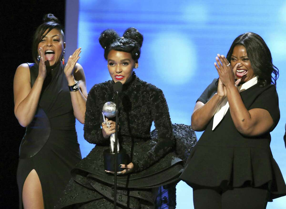 """Taraji P. Henson, from left, Janelle Monae, and Octavia Spencer accept the award for outstanding motion picture for """"Hidden Figures"""" at the 48th annual NAACP Image Awards at the Pasadena Civic Auditorium on Feb. 11, 2017 in Pasadena, Calif."""
