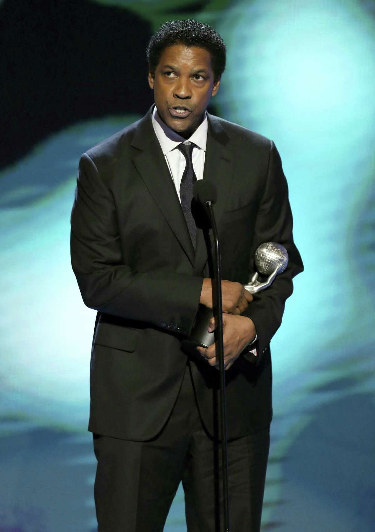 """Denzel Washington accepts the award for outstanding actor in a motion picture for """"Fences"""" at the 48th annual NAACP Image Awards at the Pasadena Civic Auditorium on Feb. 11, 2017 in Pasadena, Calif."""