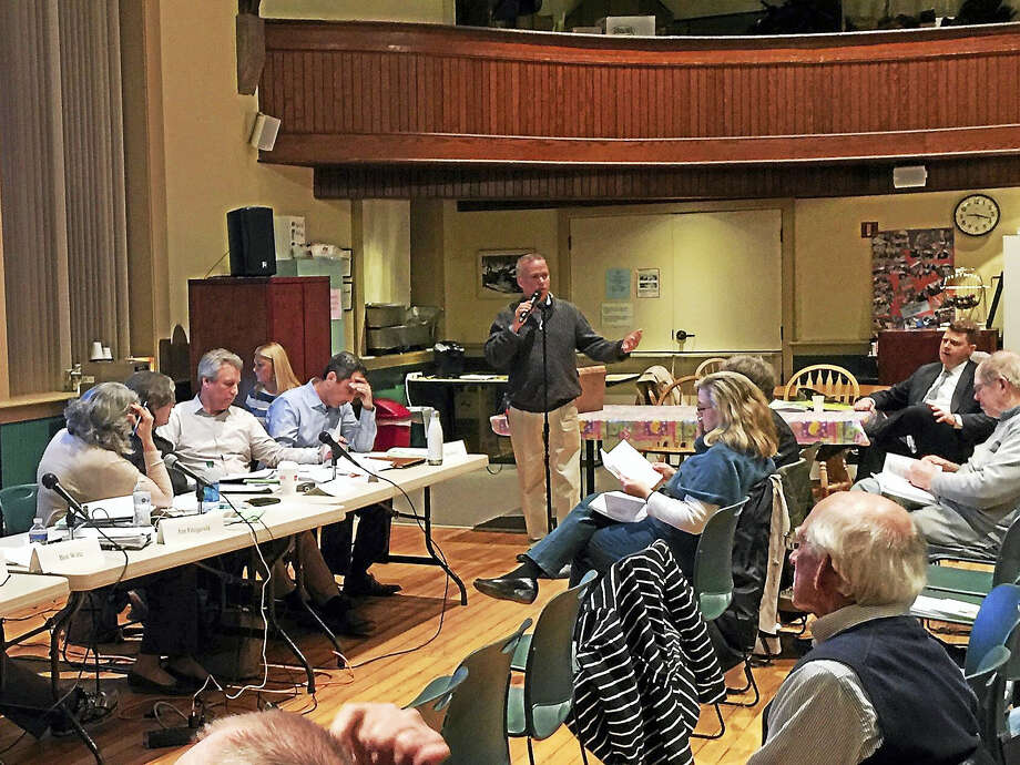 New Hartford residents turned out to consider the budgets proposed for the 2018 fiscal year in the community Tuesday evening. Above, First Selectman Dan Jerram presents the proposed town budget. Photo: Ben Lambert — The Register Citizen