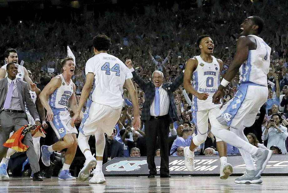 North Carolina head coach Roy Williams and players celebrate after beating Gonzaga to win the national championship Monday Glendale, Ariz. North Carolina won 71-65. Photo: David J. Phillip — The Associated Press  / Copyright 2017 The Associated Press. All rights reserved.