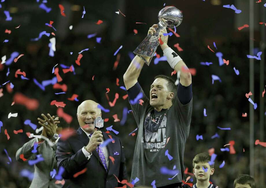 Patriots quarterback Tom Brady, right, celebrates with the Vince Lombardi Trophy next to broadcaster Terry Bradshaw after winning Super Bowl 51. Photo: The Associated Press File Photo  / Copyright 2017 The Associated Press. All rights reserved.