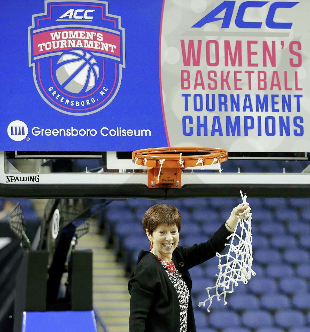 """In this March 8, 2015 photo, Notre Dame head coach Muffet McGraw celebrates after an NCAA college basketball game against Florida State in the championship of the Atlantic Coast Conference tournament in Greensboro, N.C. The NCAA says it will consider North Carolina as a host for championship events again after the state rolled back a law that limited protections for LGBT people. In a statement on April 4, 2017, the governing body said its Board of Governors had reviewed moves to repeal repealed the so-called """"bathroom bill"""" and replace it with a compromise law."""