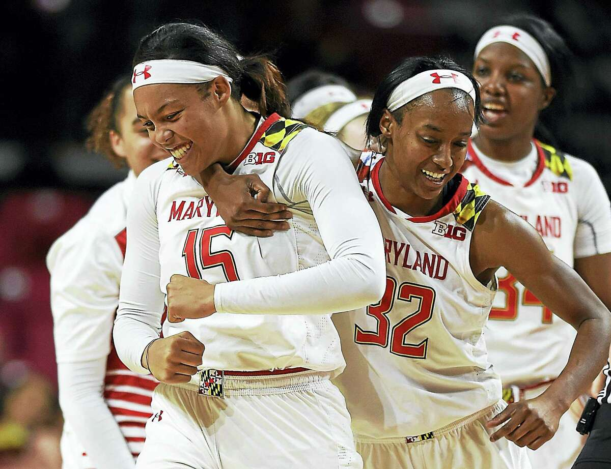 Maryland's Kiah Gillespie, left, is hugged by Shatori Walker-Kimbrough after she made a 3-pointer at the buzzer against Michigan during the second half of an NCAA college basketball game, Thursday, Jan. 19, 2017, in College Park, Md. Maryland won 83-70. (AP Photo/Gail Burton)
