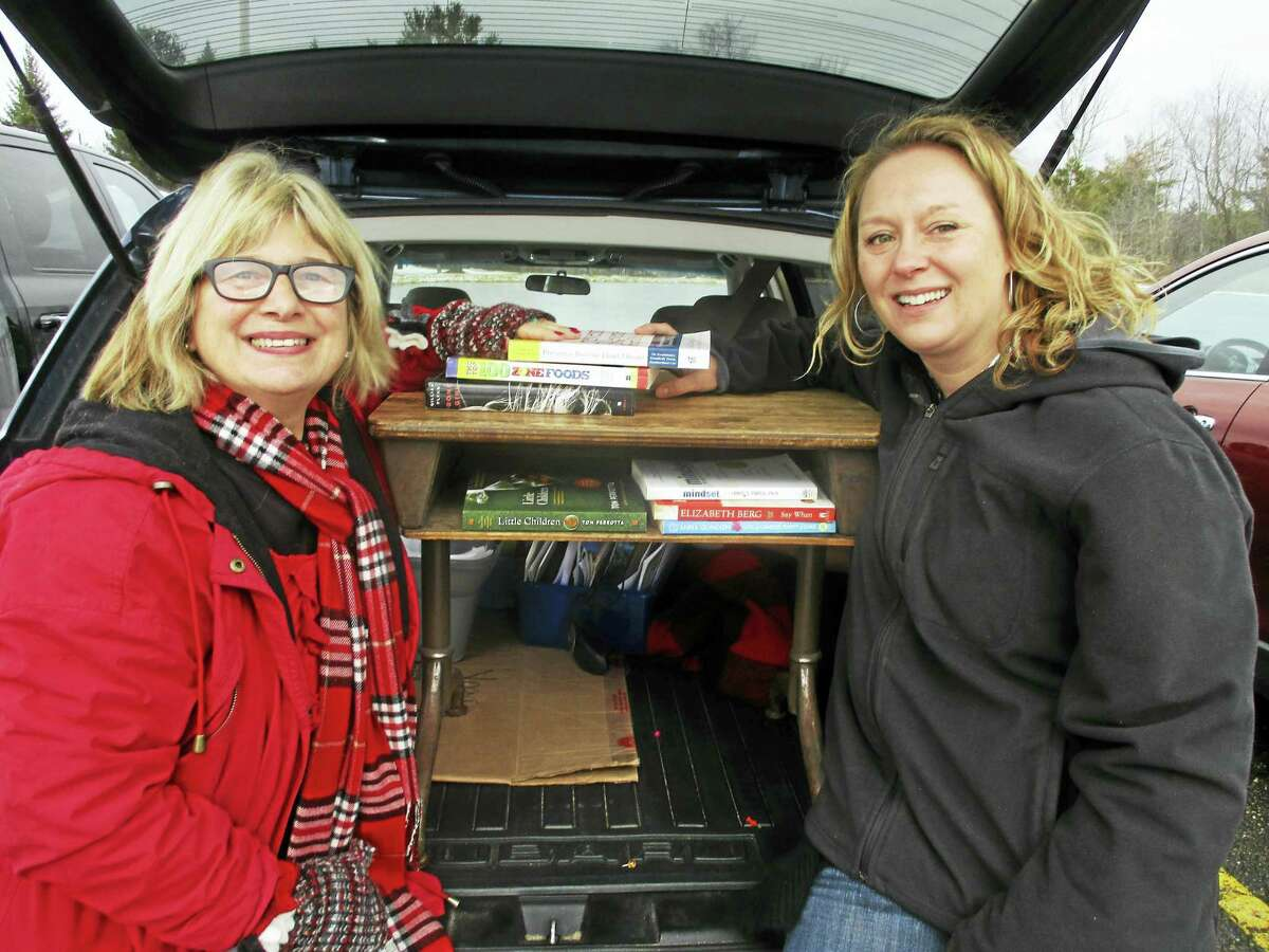 Little Free Library Stewards Rose Buckens and Bethany Cassiday are preparing for a tag sale on Feb. 18-19 in Litchfield.