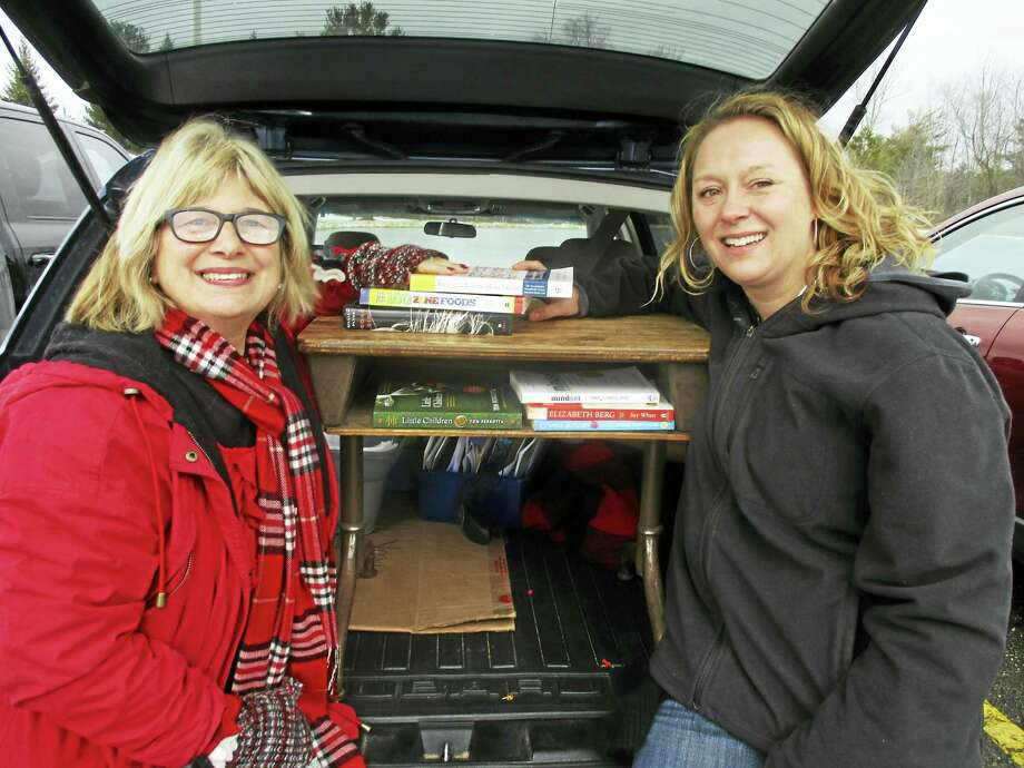 Little Free Library Stewards Rose Buckens and Bethany Cassiday are preparing for a tag sale on Feb. 18-19 in Litchfield. Photo: Contributed Photo