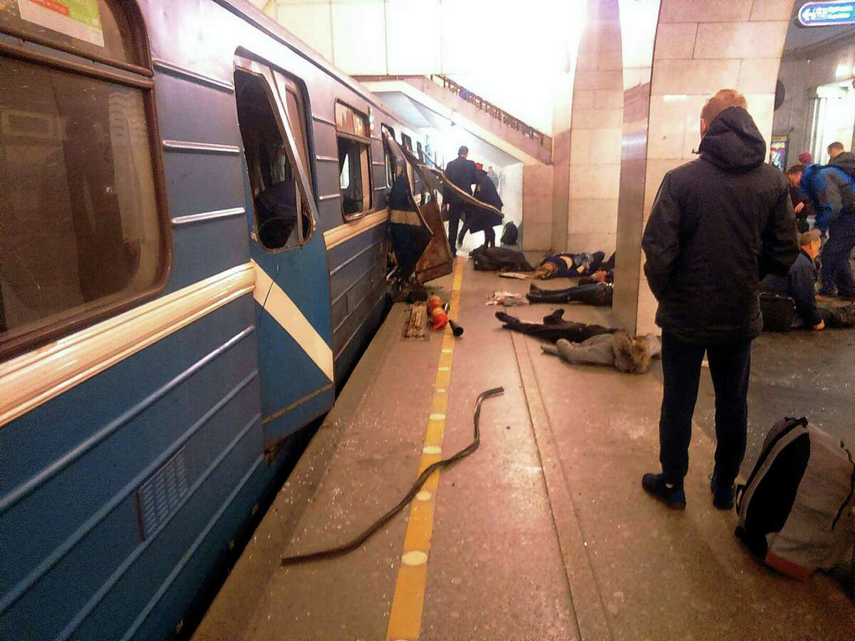 Blast victims lie near a subway train hit by a explosion at the Tekhnologichesky Institut subway station in St.Petersburg, Russia on April 3, 2017. The subway in the Russian city of St. Petersburg is reporting that several people have been injured in an explosion on a subway train.