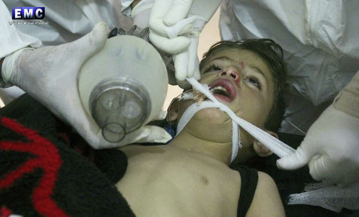 This photo provided April 4, 2017 by the Syrian anti-government activist group Edlib Media Center, which has been authenticated based on its contents and other AP reporting, shows Syrian doctors treating a child following a suspected chemical attack, at a makeshift hospital, in the town of Khan Sheikhoun, northern Idlib province, Syria. The suspected chemical attack killed dozens of people on Tuesday, Syrian opposition activists said, describing the attack as among the worst in the country's six-year civil war.