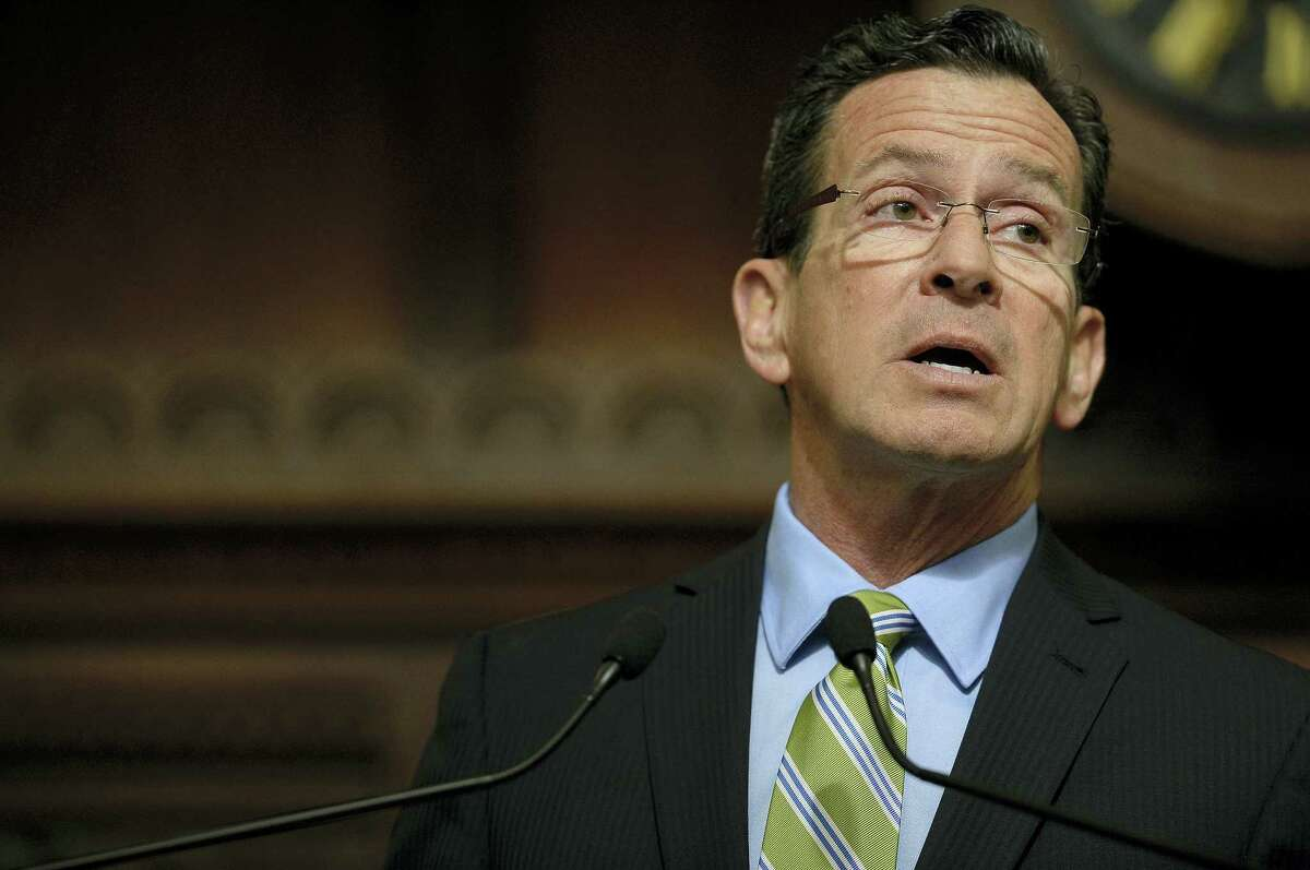 Connecticut Gov. Dannel P. Malloy delivers his budget address to members of the House and Senate inside the Hall of the House at the state Capitol in Hartford Wednesday.