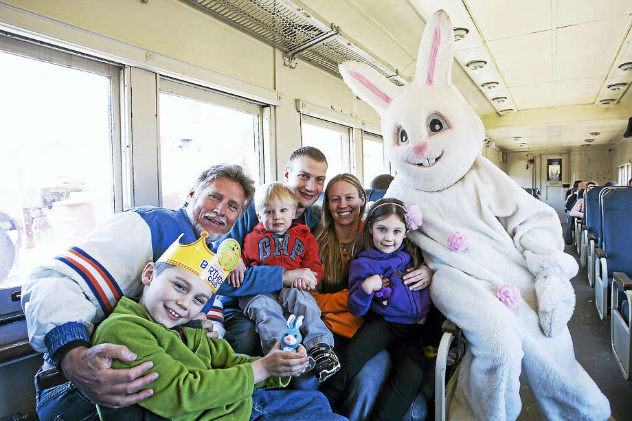 Above, the Easter Bunny rides a car on the Naugatuck Railroad with a crew of happy children during last year's event in Thomaston. He'll take the trip again this year on Saturday, April 9 and Sunday, April 15. Photo: Contributed Photo