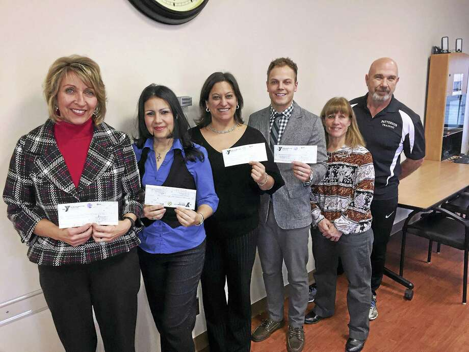 From left, Theresa Valentine of the Sunrise Foundation, CHH Pink Rose Fund Outreach Coordinator Damaris Sierra, Gina Devaux of the Susan B. Anthony Project and Mat Montgomery of NWCT YMCA, receive checks from event organizers Mandy Hill of Charlotte Hungerford Hospital Rehabilitation Services and Ed Patterson of the Torrington Missfits. Photo: Contributed Photo