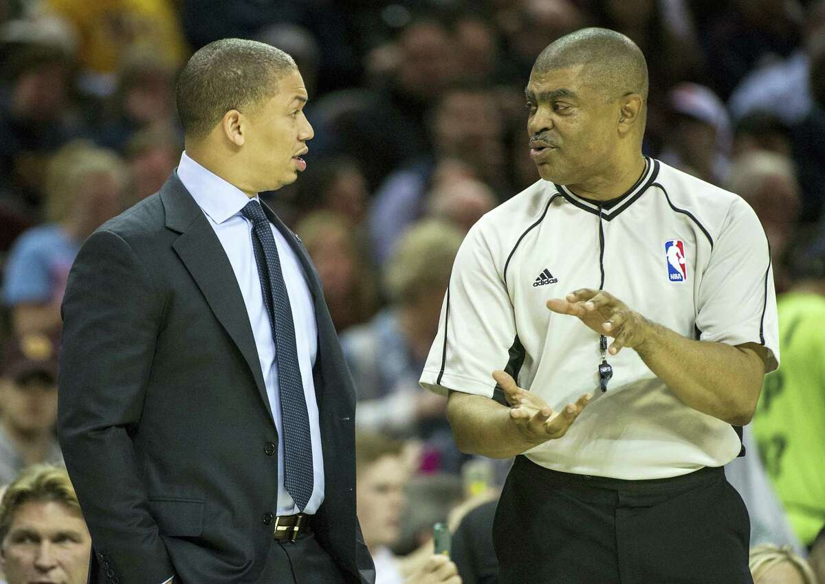 Cleveland Cavaliers head coach Tyronn Lue talks with referee Tony Brothers during the first half of an NBA basketball game against the Washington Wizards in Cleveland on Saturday, March 25, 2017.