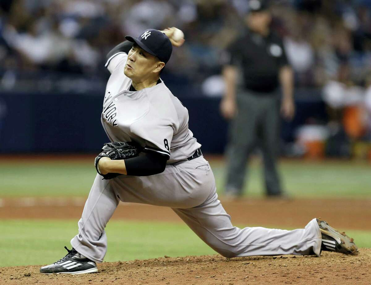 FILE - In this Sept. 21, 2016, file photo, New York Yankees' Masahiro Tanaka, of Japan, pitches to the Tampa Bay Rays during the sixth inning of a baseball game in St. Petersburg, Fla. Tanaka says he is not thinking about his ability to opt out of his contract following this season, give up $69 million in salary from 2018-20 and become a free agent. (AP Photo/Chris O'Meara, File)