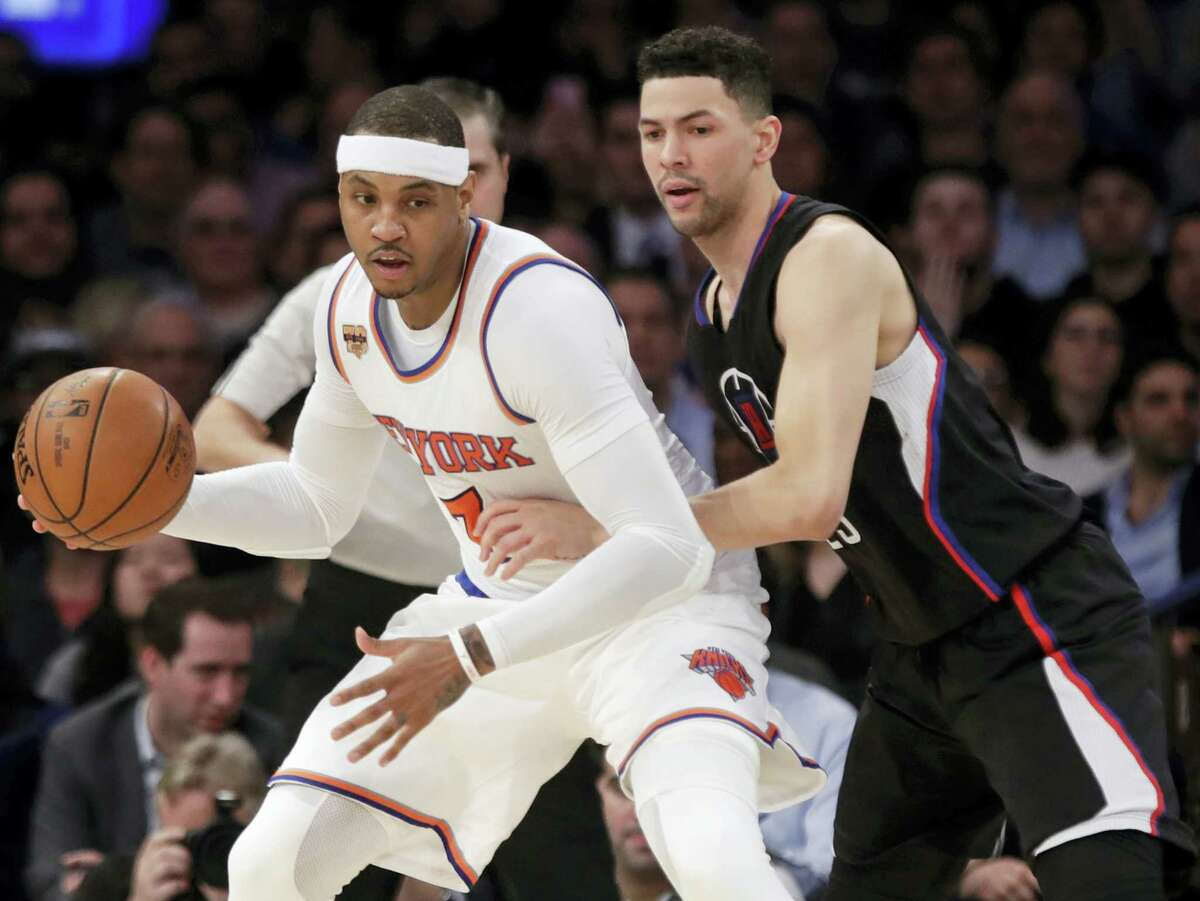 LA Clippers' Austin Rivers (25) defends New York Knicks' Carmelo Anthony (7) during the first half of an NBA basketball game on Wednesday, Feb. 8, 2017 in New York.