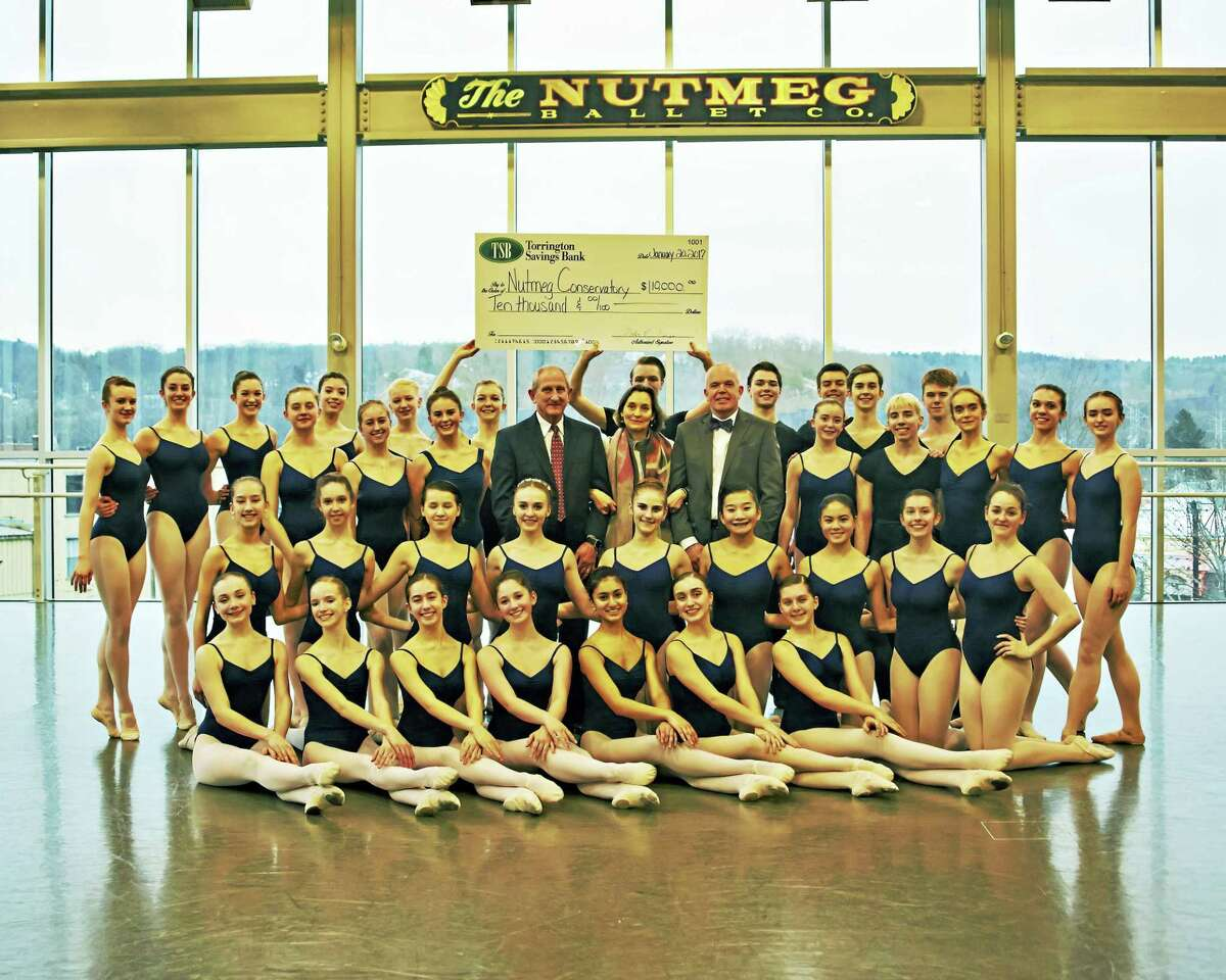 The Nutmeg Ballet Conservatory dancers are joined by John E. Janco, President & CEO of Torrington Savings Bank, Victoria Mazzarelli, The Nutmeg Ballet Conservatory Artistic Director, and Jeff Geddes, Senior Vice President of Torrington Savings Bank.
