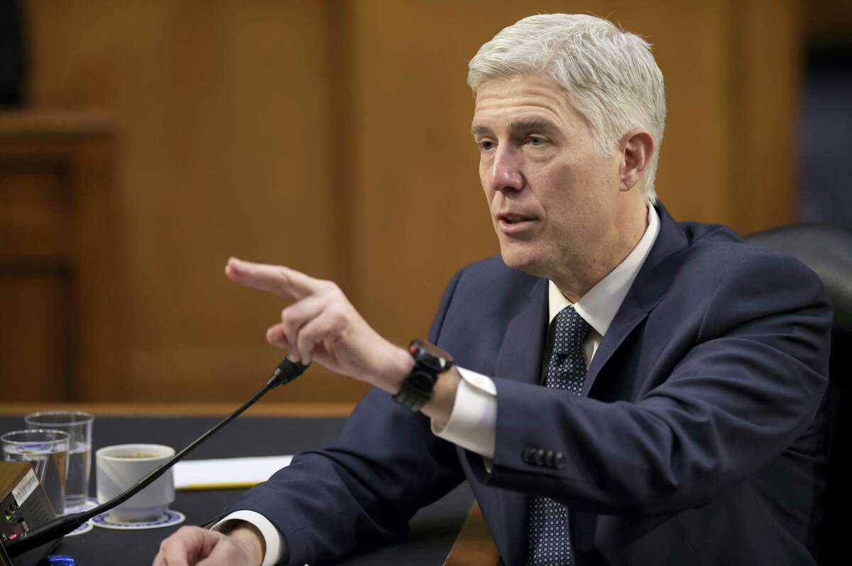 In this March 22, 2017 photo, Supreme Court Justice nominee Neil Gorsuch testifies on Capitol Hill in Washington before the Senate Judiciary Committee. Senate Democratic opposition to President Donald Trump's Supreme Court nominee swelled Friday, March 31, 2017 as Democrats neared the numbers needed for a filibuster, setting up a showdown with Republicans who have the votes to confirm Neil Gorsuch.