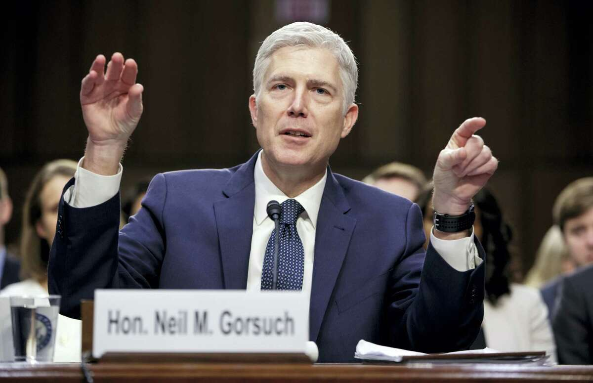 In this March 22, 2017 photo, Supreme Court Justice nominee Judge Neil Gorsuch testifies on Capitol Hill in Washington, at his confirmation hearing before the Senate Judiciary Committee. The Senate is headed for a tense showdown over President Donald Trump's Supreme Court nominee that could have far-reaching consequences for Congress, the high court and the nation.