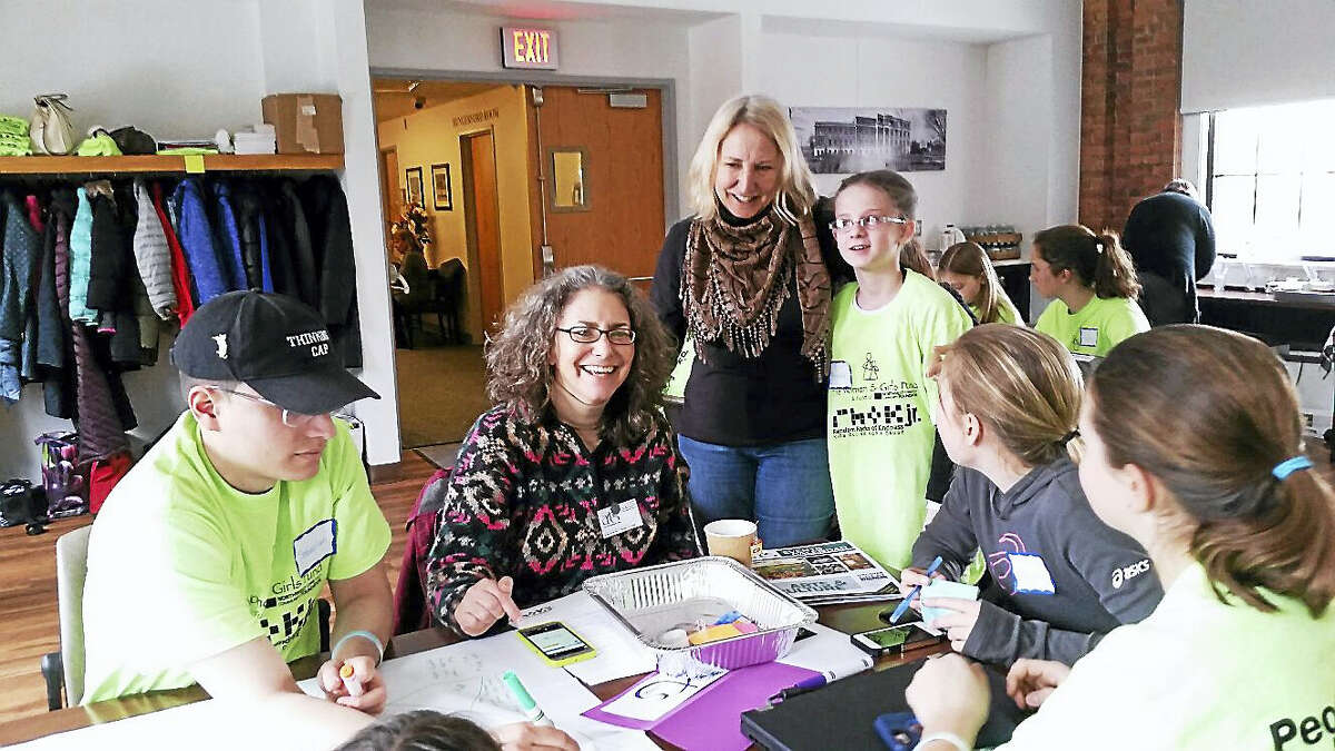 """Amy Wynn, executive director of Torrington's Northwest Connecticut Arts Council; former state Rep. Roberta Willis of Lakeville; and Willis' granddaughter Hannah Turgeon, 10, of Torrington participated in the second annual """"Hackathon Coding for a Cause"""" program on Saturday morning at the Charlotte Hungerford Hospital Memorial Building."""