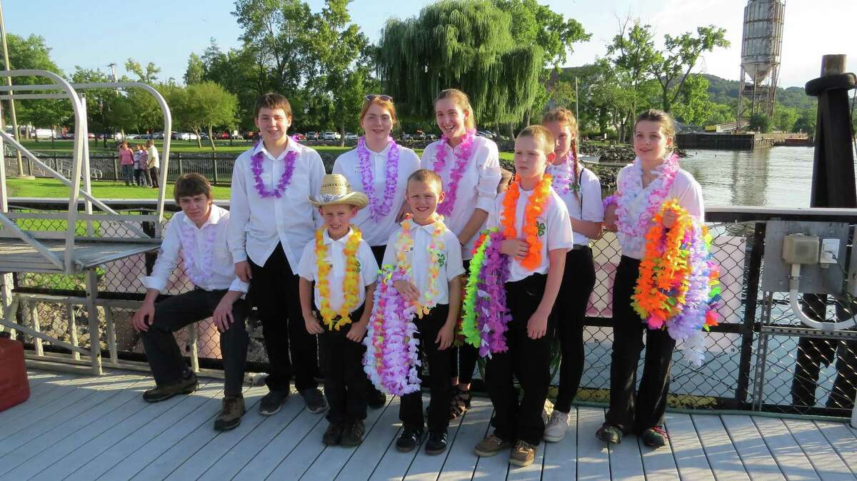 Local 4-H youth members man the dock to greet passengers as they board the Marika yacht for Cornell Cooperative Extension of Columbia and Greene Counties' 2017 centennial celebration. The yacht sailed the Hudson for two hours of dining, music and games for the sold-out fundraising dinner. (Submitted photo)