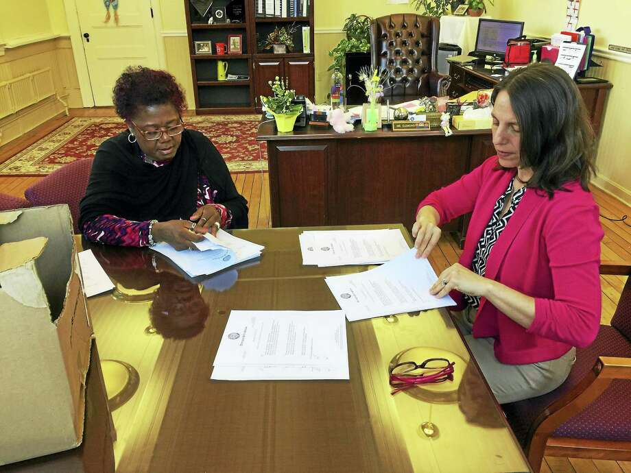 The date of graduation will be changed to June 25, after the Torrington senior class chose that as its preferred option Monday. Above, Superintendent of Schools Denise Clemons, left, counts ballots with a staff member. Photo: Ben Lambert — The Register Citizen