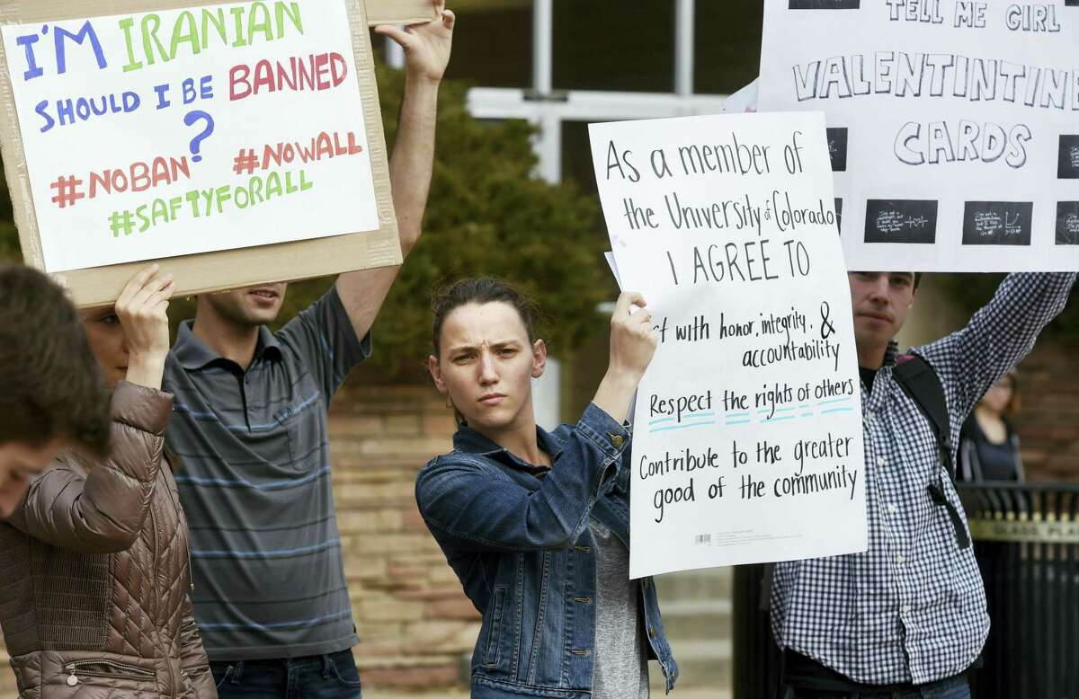 Allie Morgan, a University of Colorado graduate student, is among dozens of people at a travel ban protest at the University of Colorado in Boulder on Thursday.