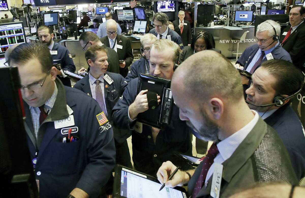 Stock traders follow market activity Thursday at the New York Stock Exchange.