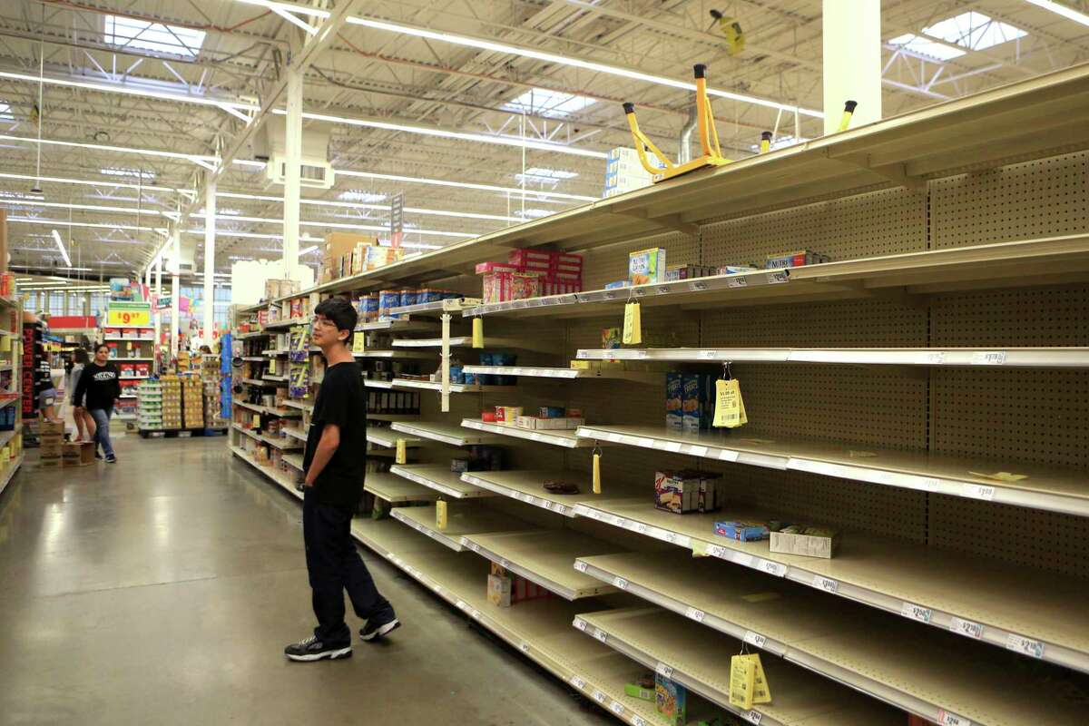 Logan Garcia looks for last-minute supplies at H-E-B Plus in Corpus Christi, Texas, Friday, Aug. 25, 2017, just minutes before it closes as Hurricane Harvey nears the coast. (Rachel Denny Clow/Corpus Christi Caller-Times via AP) ORG XMIT: TXCOR104