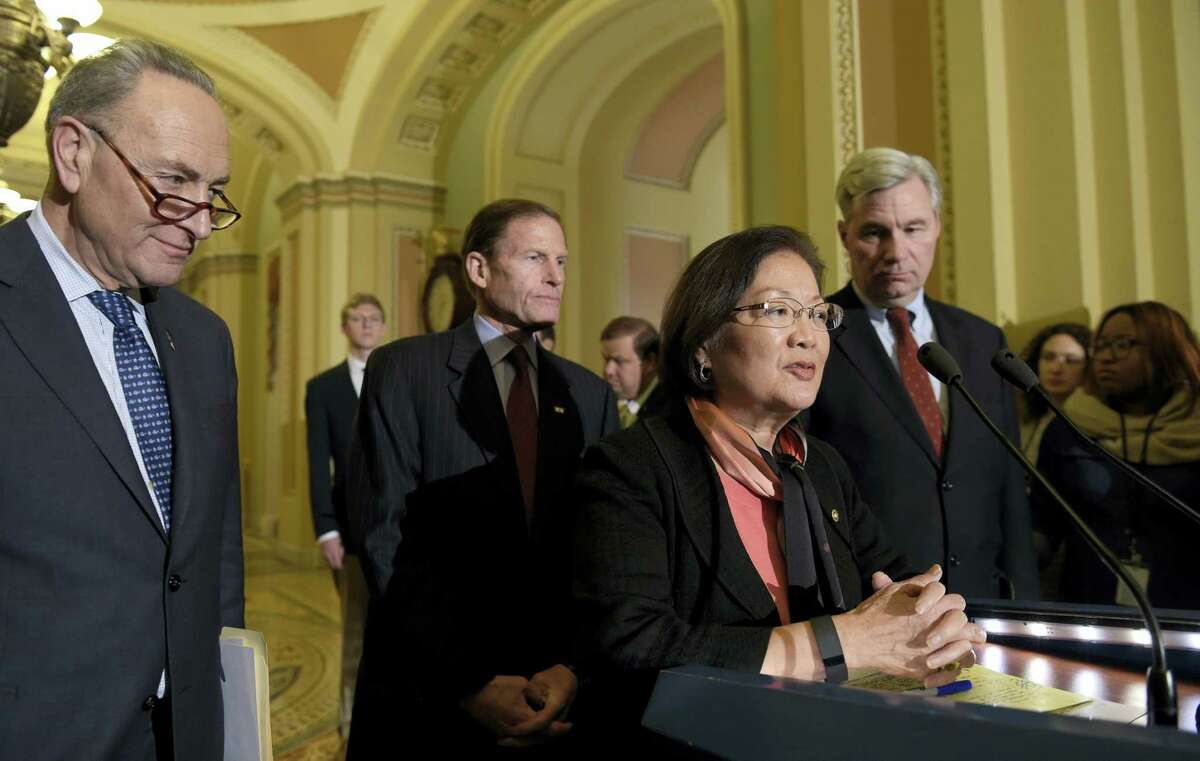 Sen. Mazie Hirono, D-Hawaii, second from right, speaks to reporters during a news conference on Capitol Hill in Washington, Tuesday, Feb. 7, 2017. From left are, Senate Minority Leader Charles Schumer of N.Y., Sen. Richard Blumenthal, D-Conn., and Sen. Sheldon Whitehouse, D-R.I.