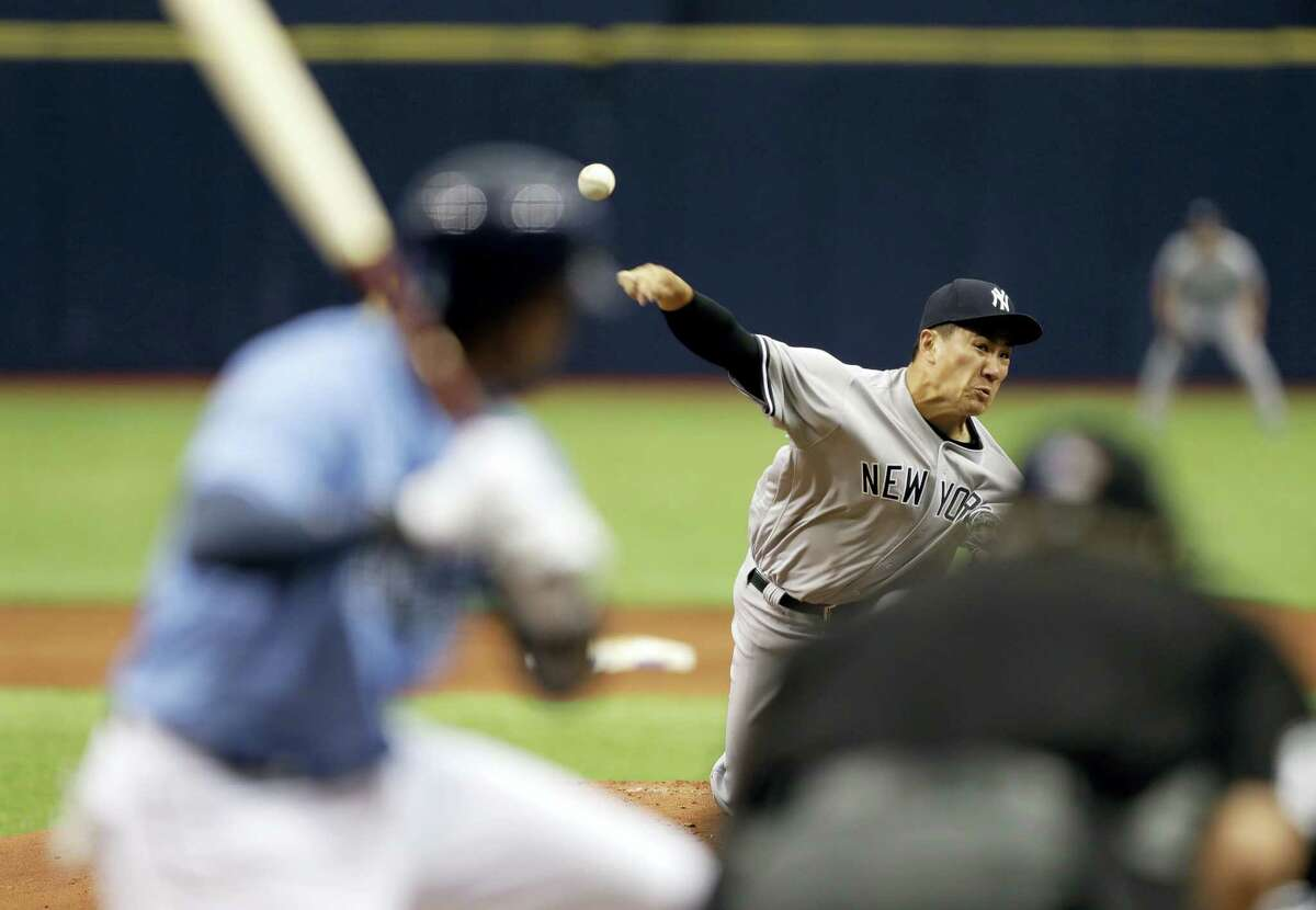 Yankees starting pitcher Masahiro Tanaka delivers in the first inning Sunday in St. Petersburg, Fla.