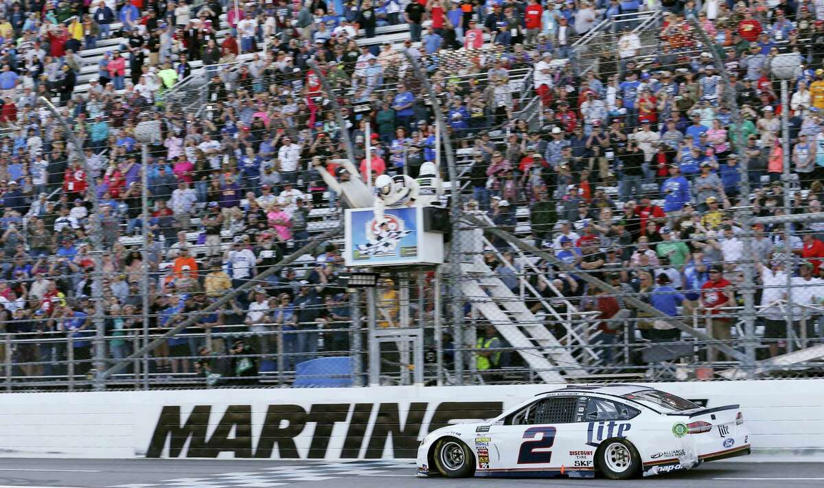 Brad Keselowski crosses the finish line to win at Martinsville Speedway on Sunday.
