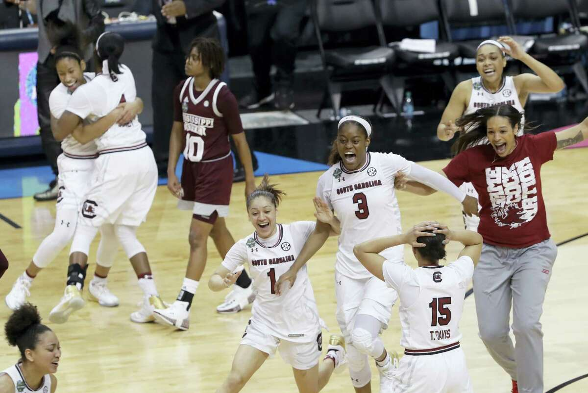 South Carolina players celebrate their win over Mississippi State in the national championship game Sunday in Dallas.