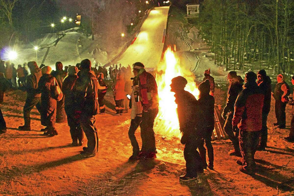 Human Dog Sled participants stay warm by the bonfire during last year's event.