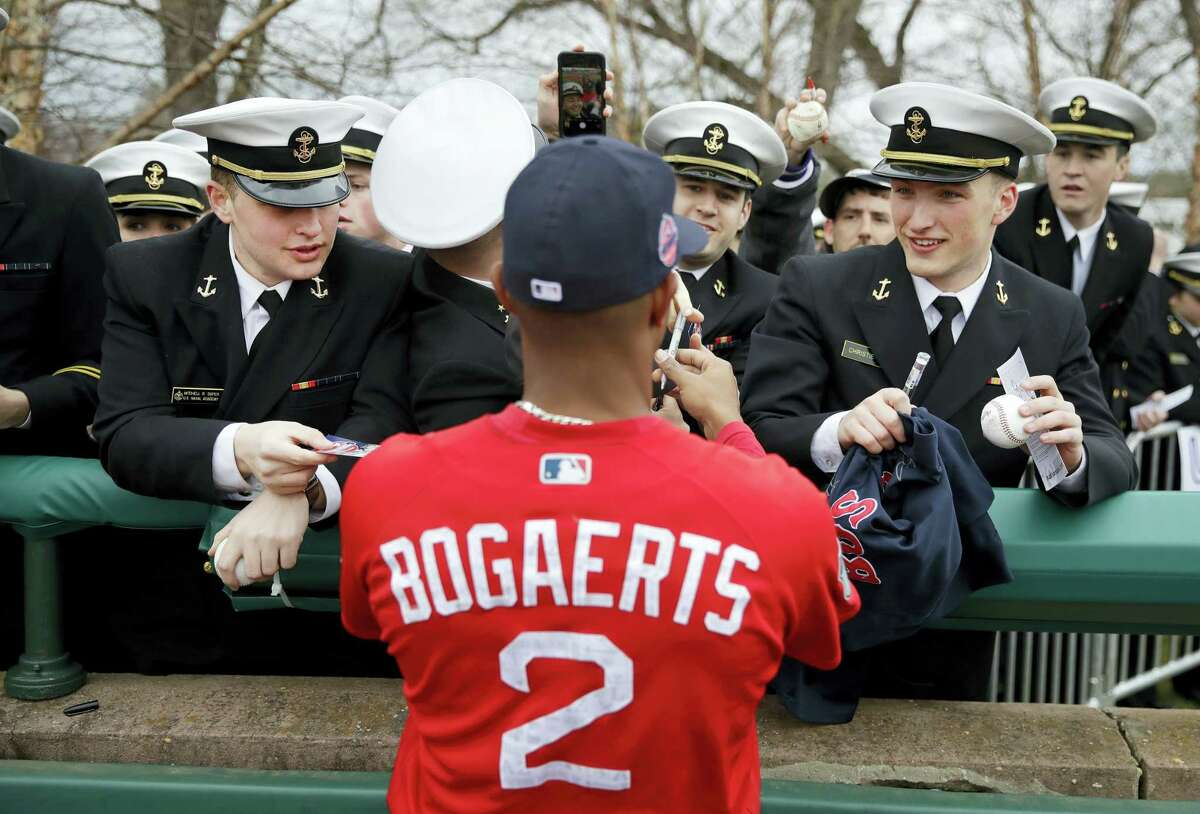 Midshipmen reach out for autographs from Red Sox shortstop Xander Bogaerts before an exhibition game between the Red Sox and Nationals at the U.S. Naval Academy in Annapolis, Md., on Saturday.