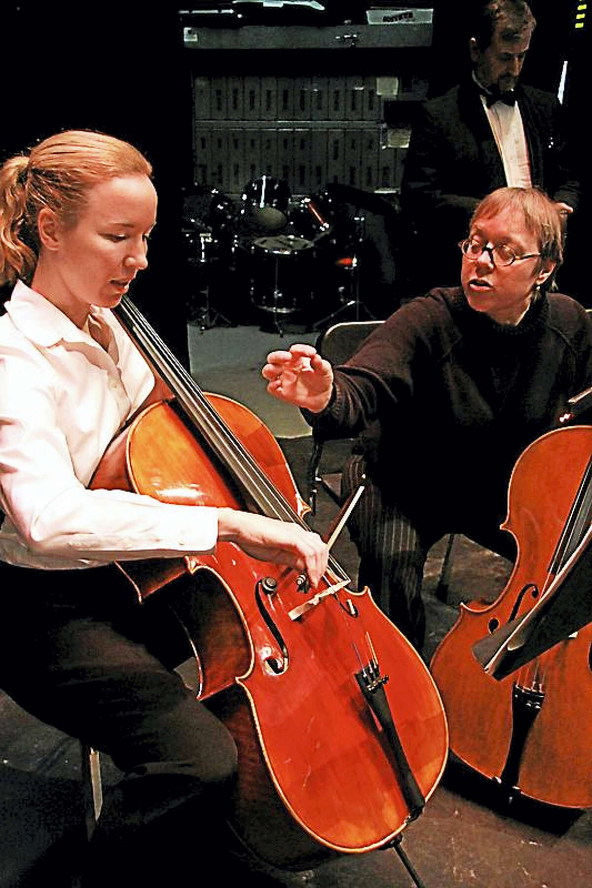 A member of the WSO instructs a student during rehearsal.