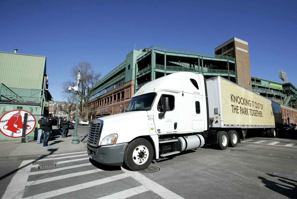The Red Sox baseball equipment truck departs Fenway Park Monday in Boston en route to the team's spring training facility in Fort Myers, Fla.