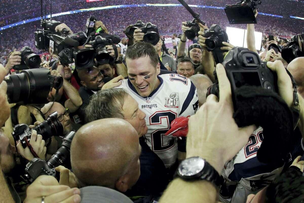 Patriots head coach Bill Belichick embraces Tom Brady after winning the Super Bowl on Sunday.