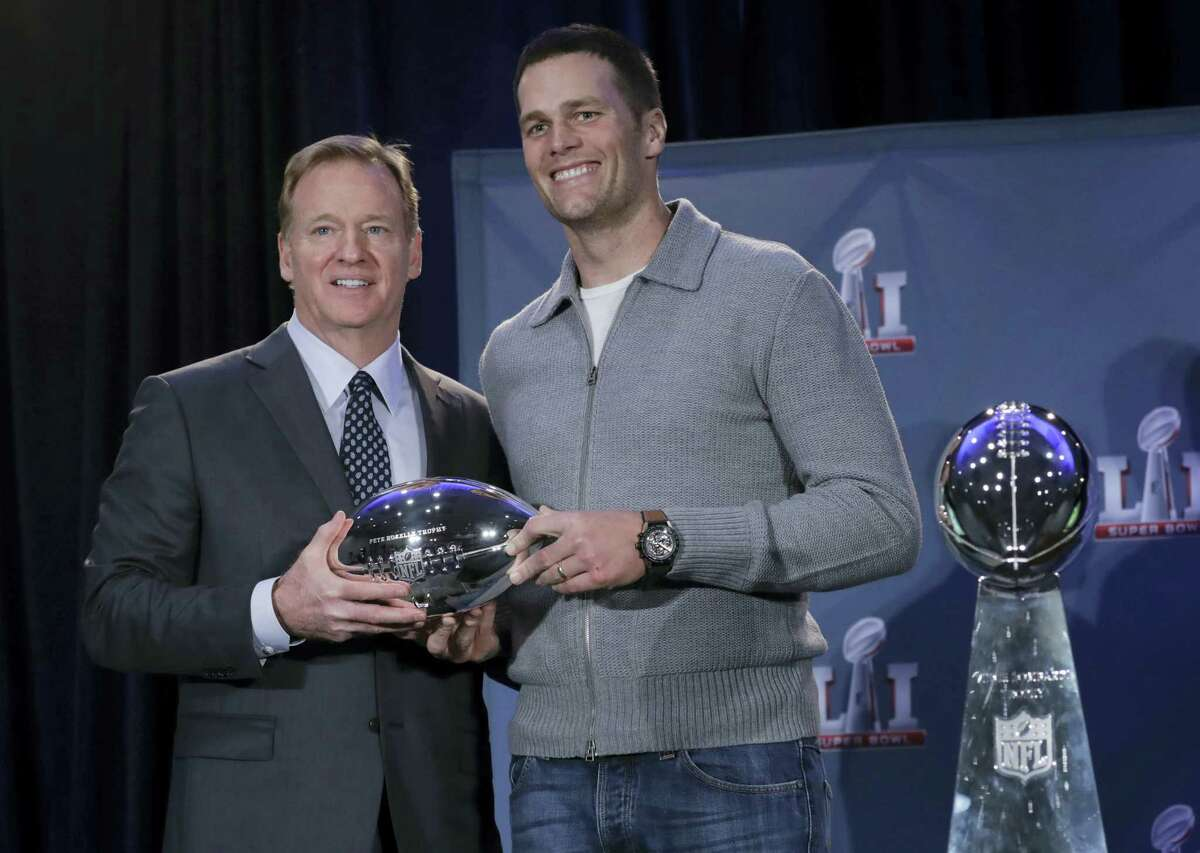 NFL commissioner Roger Goodell and Patriots quarterback Tom Brady pose during a news conference on Monday.