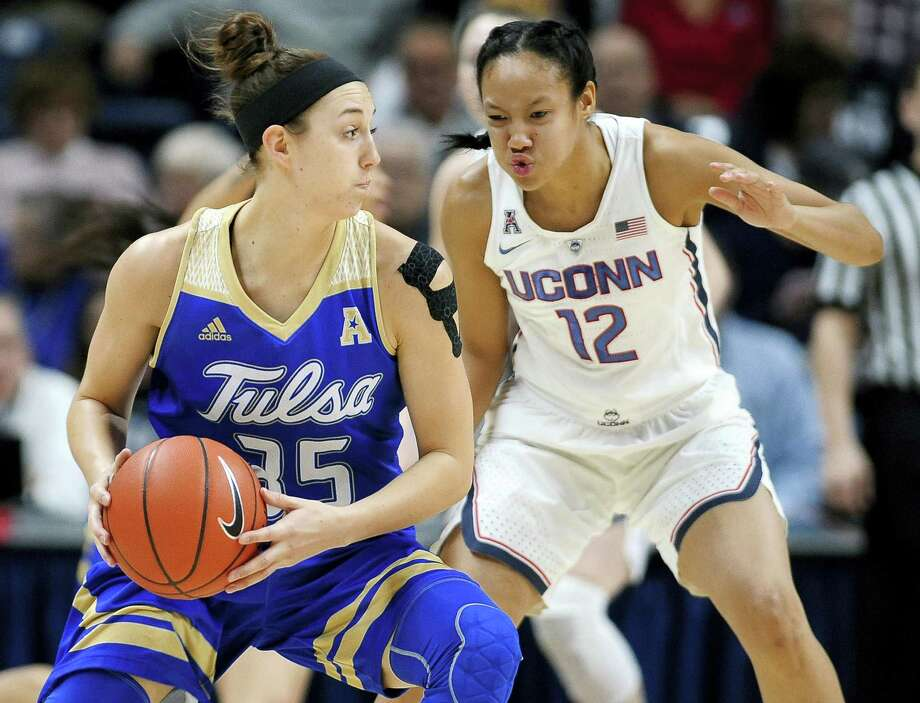 UConn's Saniya Chong, right, guards Tulsa's Liesl Spoerl during Sunday's game in Storrs. Photo: Jessica Hill — The Associated Press  / AP2017