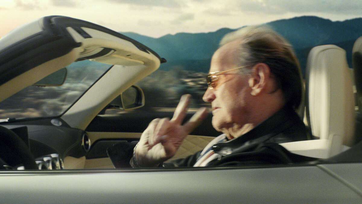 """This photo provided by Mercedes-Benz USA shows an image from the company's """"Easy Driver"""" Super Bowl 51 commercial. To target baby boomers, Mercedes-Benz enlisted the Coen Bros. to direct an update to the tune of Steppenwolf'Äôs 'ÄúBorn to be Wild.'Äù Bikers at a bar are furious that their bikes have been blocked by a car, until they realize its Peter Fonda driving a Mercedes-Benz AMG Roadster."""
