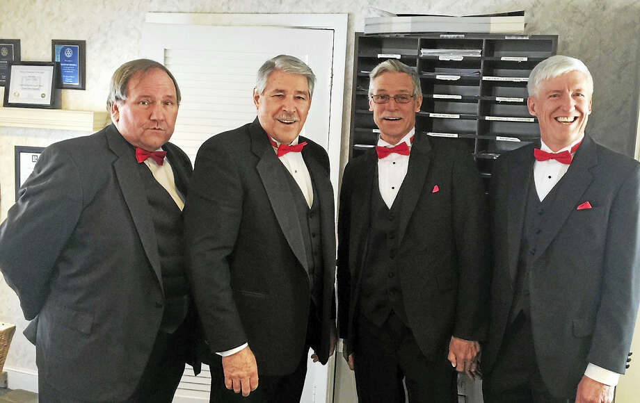 The Valley Chordsmen will be performing singing valentines again this year. A tuxedo-clad barbershop quartet will present a long stemmed rose with a valentine card and sing an appropriate song to the sweetheart of your choice at the time and location requested.   In the past quartets have performed in schoolrooms, offices, hospital rooms, family kitchens and restaurants and have delighted the surprised recipient. The cost of this service is negotiable from $50.00 to $100.00 depending on time and location in the greater Naugatuck Valley area.  Singing valentines are available Tuesday, February 14, from 9:00a.m. until 8:00p.m.   Please call in advance: John Wick (203) 233-0269. Photo: CREDIT HERE
