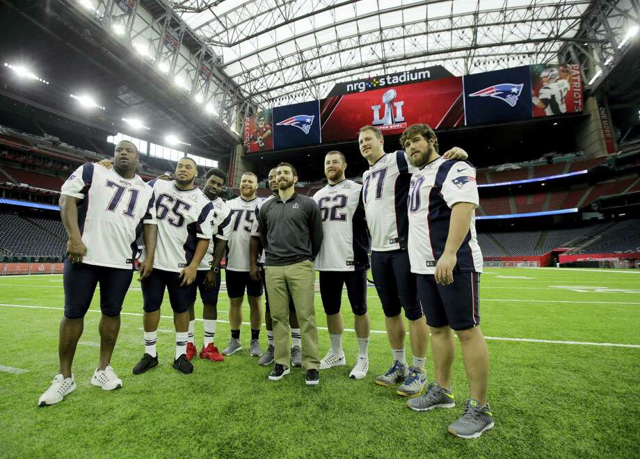 New England Patriots players pose for a photo during a walk through at NRG Stadium, site of the NFL Super Bowl 51 football game on Feb. 4, 2017 in Houston. The Patriots will face the Atlanta Falcons in the Super Bowl Sunday. Photo: AP Photo/Charlie Riedel  / Copyright 2017 The Associated Press. All rights reserved.