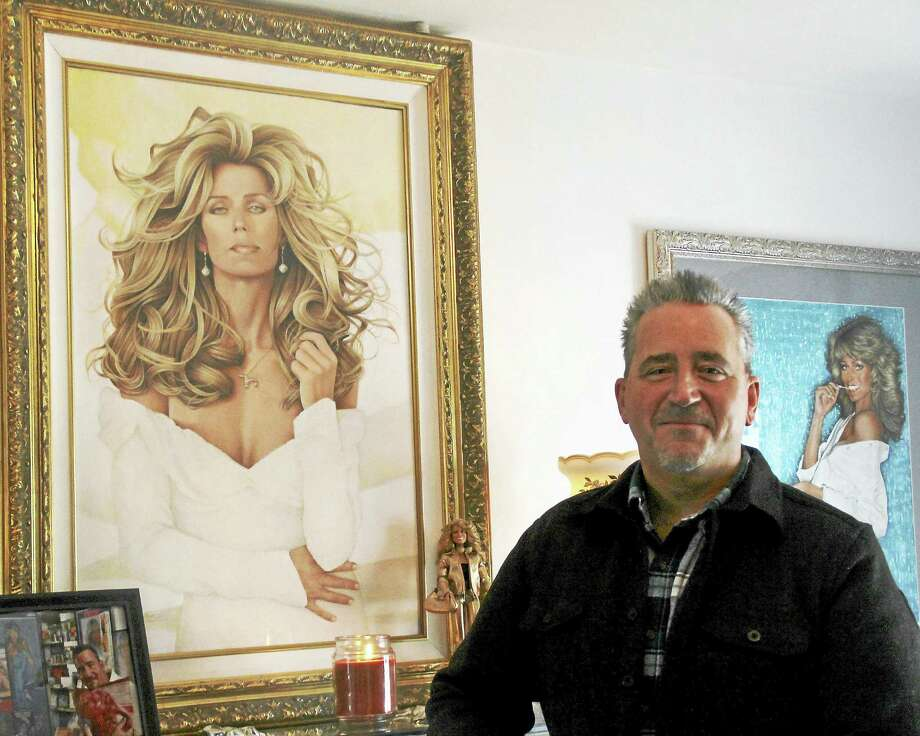 Andrew Morro poses next to a portrait of Farrah Fawcett he commissioned to artist Jonathan Dwayne, of Puerto Rico. Though Fawcett is well-known for a sunning smile, filled with Chiclet-like, super white teeth, Morro preferred a more elegant look, he said. Photo: Kathleen Schassler — New Haven Register  / Kathleen Schassler All Rights