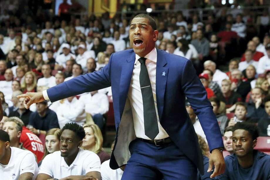 UConn coach Kevin Ollie directs his players from the bench on Saturday. Photo: John Minchillo — The Associated Press  / AP