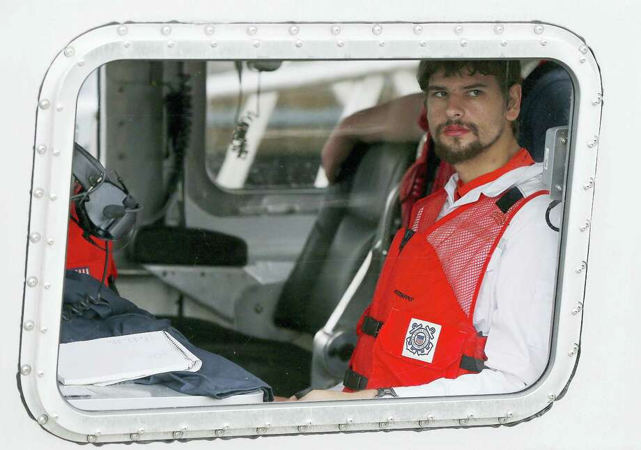 Nathan Carman arrives in a small boat at the US Coast Guard station in Boston, Tuesday, Sept. 27, 2016. Carman spent a week at sea in a life raft before being rescued by a passing freighter. Photo: Michael Dwyer — AP Photo / Copyright 2016 The Associated Press. All rights reserved.