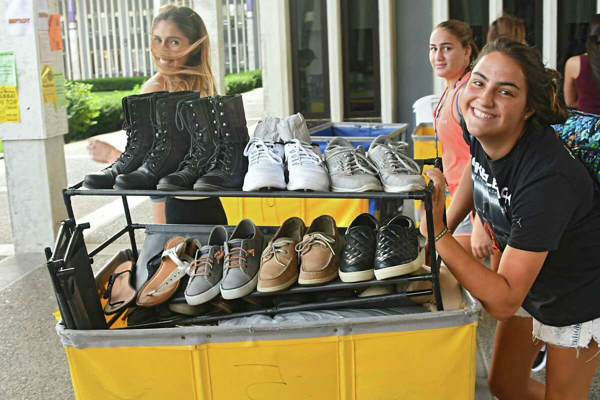 Sophomore Victoria Musachio of Long Island, second from right, gets help moving belongings into her dorm from her friend Gabriella Mignone of Queens, left, and sister Isabella Musachio, right, at University at Albany on Friday, Aug. 25, 2017 in Albany, N.Y. (Lori Van Buren / Times Union)