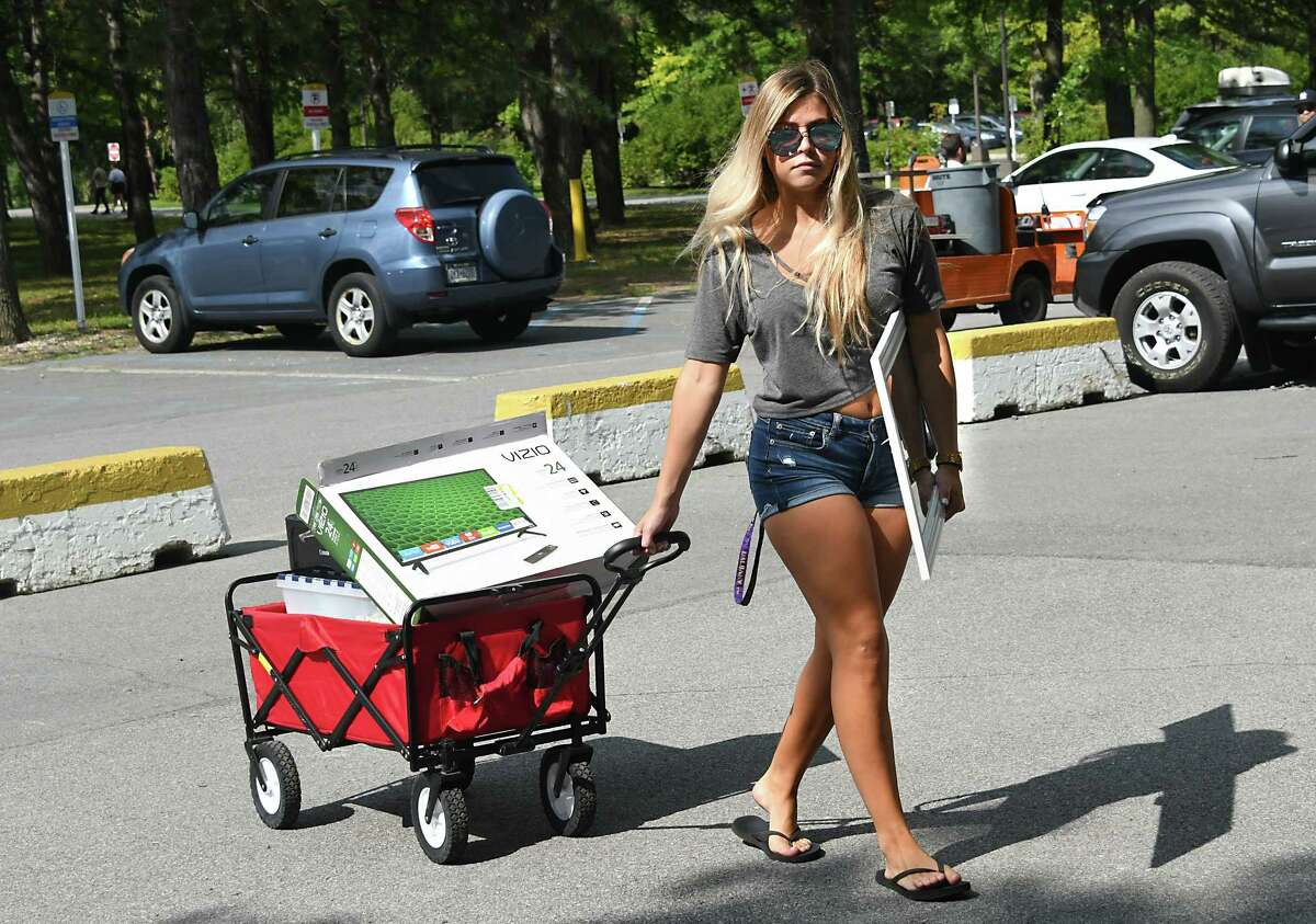 Sophomore Tiffany Horn of Carmel, NY moves her belongings into her dorm at University at Albany on Friday, Aug. 25, 2017 in Albany, N.Y. (Lori Van Buren / Times Union)