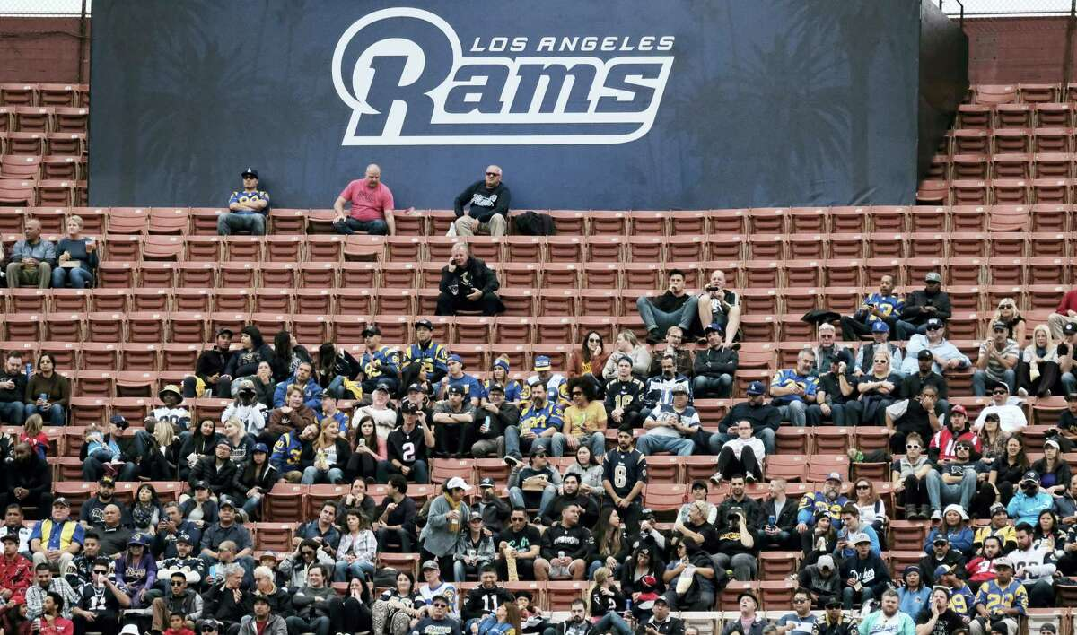 Surrounded by empty seats, Los Angeles Rams fans watch their team play the Atlanta Falcons. TV ratings declined 8 percent, with the presidential election partly, but not solely, to blame. Many of the league's highest-profile contests were boring blowouts, including eight of the 10 playoff games leading to Sunday's Super Bowl between the Patriots and Falcons.