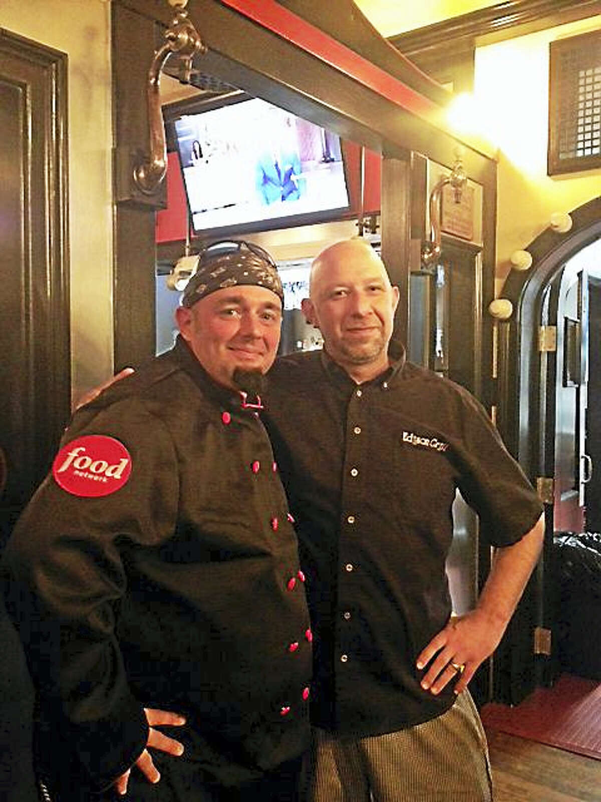 """Winsted native Dan Shopey, left, appeared on the Food Network program """"Bakers vs. Fakers"""" Wednesday. He is pictured with Jerry Czyz at the Edison Grill in Harwinton."""