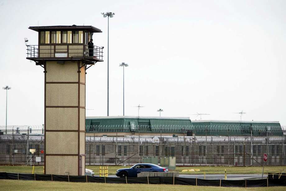 A prison guard stands at one of the towers at  James T. Vaughn Correctional Center. All Delaware prisons went on lockdown Wednesday, Feb. 1, 2017,  due to a hostage situation unfolding at the James T. Vaughn Correctional Center in Smyrna. Geoffrey Klopp, president of the Correctional Officers Association of Delaware, said he had been told by the Department of Correction commissioner that prison guards had been taken hostage. Photo: Suchat Pederson — The Wilmington News-Journal Via AP   / USA TODAY NETWORK